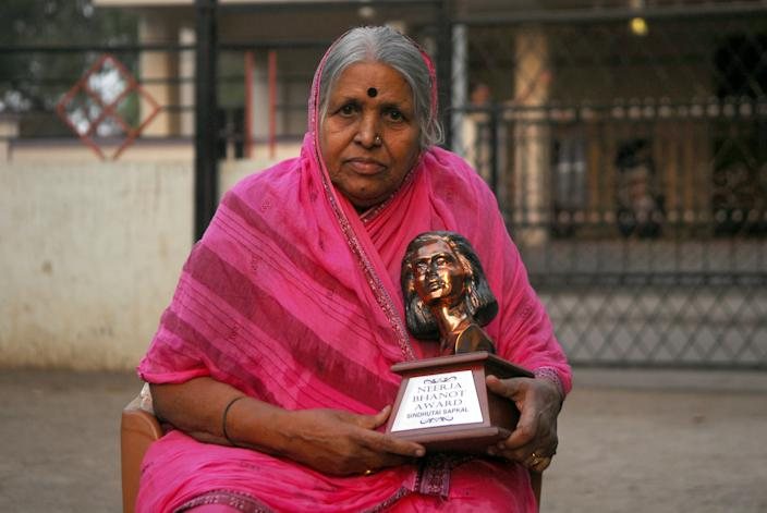 Sindhutai Sapkal, 68, poses with one of her awards in the courtyard of the orphanage run by her, on February 16, 2017 in Pune, Maharashtra, India. PHOTOGRAPH BY Nagesh Ohal / Barcroft Media via Getty Images / Barcroft Media via Getty Images)