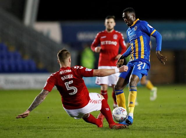 "Soccer Football - League One - Shrewsbury Town vs Charlton Athletic - Montgomery Waters Meadow, Shrewsbury, Britain - April 17, 2018 Charlton's Patrick Bauer in action with Shrewsbury Town's Abo Eisa Action Images/Andrew Boyers EDITORIAL USE ONLY. No use with unauthorized audio, video, data, fixture lists, club/league logos or ""live"" services. Online in-match use limited to 75 images, no video emulation. No use in betting, games or single club/league/player publications. Please contact your account representative for further details."