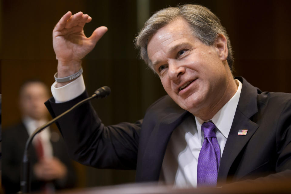 FILE - In this May 7, 2019, file photo, FBI Director Christopher Wray testifies during a hearing on Capitol Hill in Washington. Wray is set to appear before a Senate committee examining oversight of the bureau. The July 23 hearing could be something of a preview of the intense questioning special counsel Robert Mueller is likely to face when he appears before Congress the next day. (AP Photo/Alex Brandon, File)