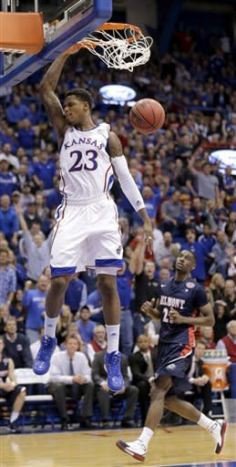 Kansas guard Ben McLemore (23) gets past Belmont guard Ian Clark (21) to dunk the ball during the first half of an NCAA college basketball game on Saturday, Dec. 15, 2012, in Lawrence, Kan. (AP Photo/Charlie Riedel)