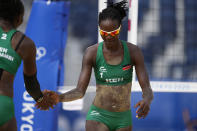 Gaudencia Makokha, right, of Kenya, celebrates a play with teammate Brackcides Khadambi, during a women's beach volleyball match against the United States at the 2020 Summer Olympics, Thursday, July 29, 2021, in Tokyo, Japan. (AP Photo/Petros Giannakouris)