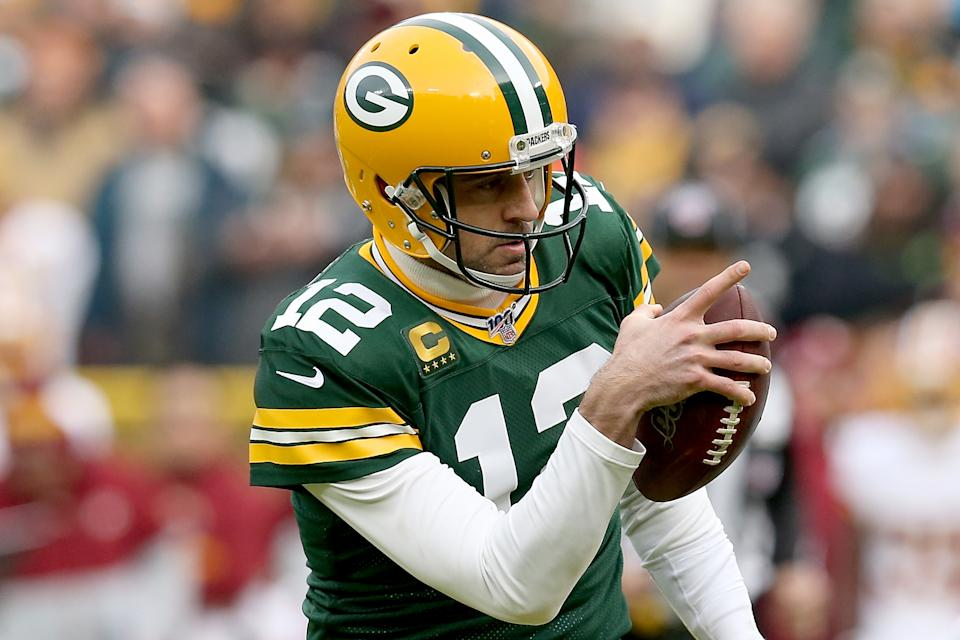 While he knows they have things to work on after sneaking past the Redskins on Sunday, Aaron Rodgers isn't concerned. After all, the Packers are 10-3. (Dylan Buell/Getty Images)
