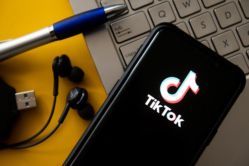 POLAND - 2020/10/20: In this photo illustration a TikTok logo seen displayed on a smartphone. (Photo Illustration by Mateusz Slodkowski/SOPA Images/LightRocket via Getty Images)
