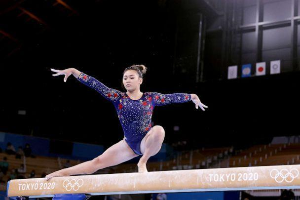 PHOTO: Sunisa Lee, of Team United States, competes on balance beam during Women's Qualification on day two of the Tokyo 2020 Olympic Games at Ariake Gymnastics Centre, July 25, 2021, in Tokyo, Japan. (Laurence Griffiths/Getty Images)