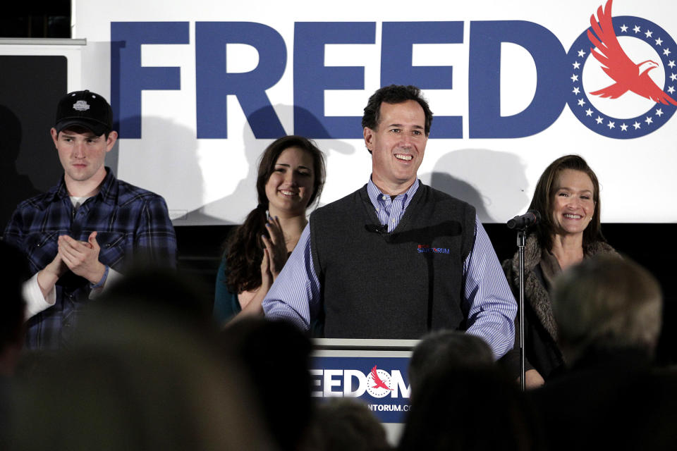 Republican presidential candidate, former Pennsylvania Sen. Rick Santorum, center, addresses supporters as he is joined by son John, left, daughter Sarah Maria and wife Karen, right, at the National Railroad Museum in Green Bay, Wis., Sunday, April 1, 2012. (AP Photo/Jae C. Hong)