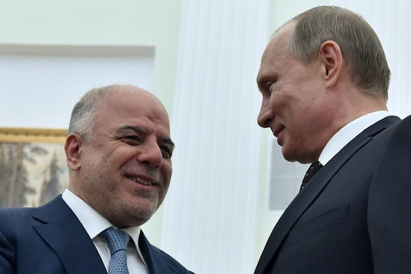 Russian President Vladimir Putin (right) greets Iraqi Prime Minister Haider al-Abadi during a meeting at the Kremlin in Moscow on May 21, 2015