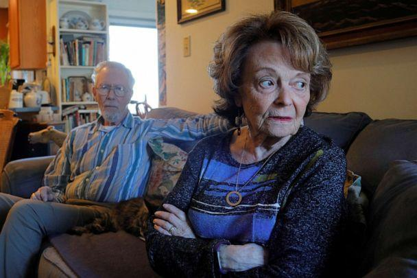 PHOTO: Cynthia Flagg sits with her husband Charles, who took part in an early stage trial of Biogen's drug aducanumab following his diagnosis with Alzheimer's disease, at their home in Jamestown, R.I., Feb. 21, 2020. (Brian Snyder/Reuters, FILE)