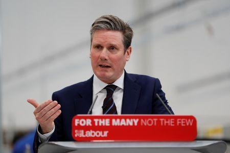 FILE PHOTO: Britain's Shadow Brexit Secretary Keir Starmer speaks at Birmingham City University in Birmingham, Britain, March 26, 2018. REUTERS/Darren Staples