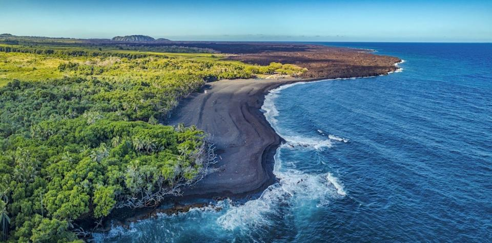 """<p>Also known as Isaac Hale Beach Park, the <a href=""""https://www.gohawaii.com/islands/hawaii-big-island/things-to-do/beaches/pohoiki-beach"""" rel=""""nofollow noopener"""" target=""""_blank"""" data-ylk=""""slk:Big Island's Pohoiki"""" class=""""link rapid-noclick-resp"""">Big Island's Pohoiki</a> black sand beach was formed after the Kilauea volcano erupted in 2018, and hot lava poured into the ocean. Enjoy this lush, pristine setting while you still can: The tides may wash away the dark sand in a few years.</p>"""