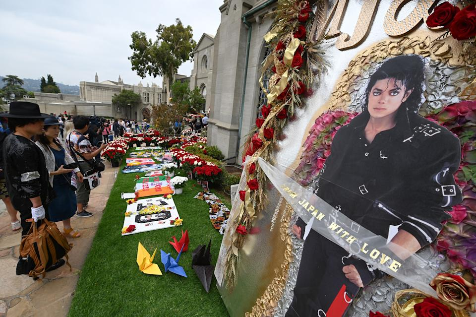 Fans visit Michael Jackson's mausoleum at Forest Lawn Cemetery in Glendale, California on June 25, 2019, the 10th anniversary of the King of Pop's death. (Photo by Robyn Beck / AFP)        (Photo credit should read ROBYN BECK/AFP/Getty Images)