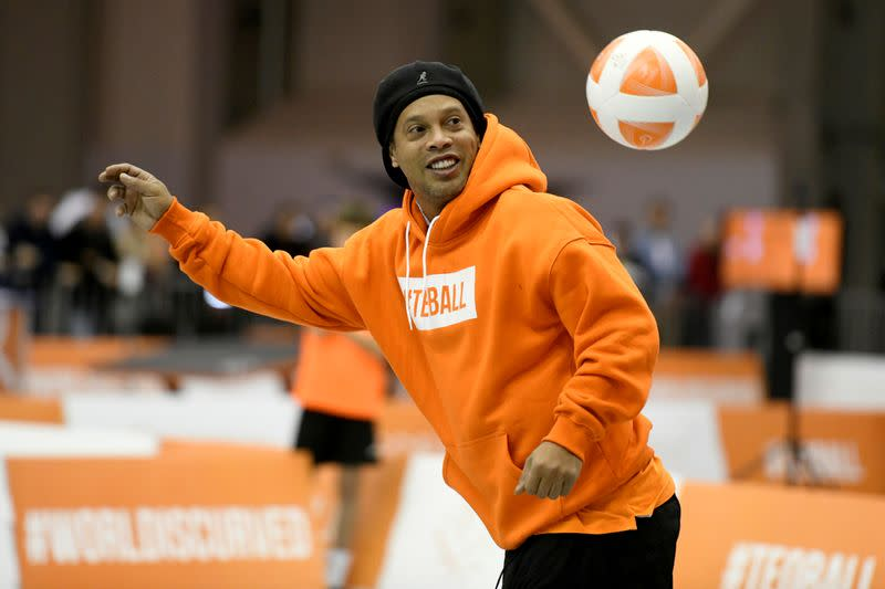 FILE PHOTO: Former FIFA player of the year and football World Cup winner Ronaldinho of Brazil plays Teqball at the Teqball World Championships in Budapest