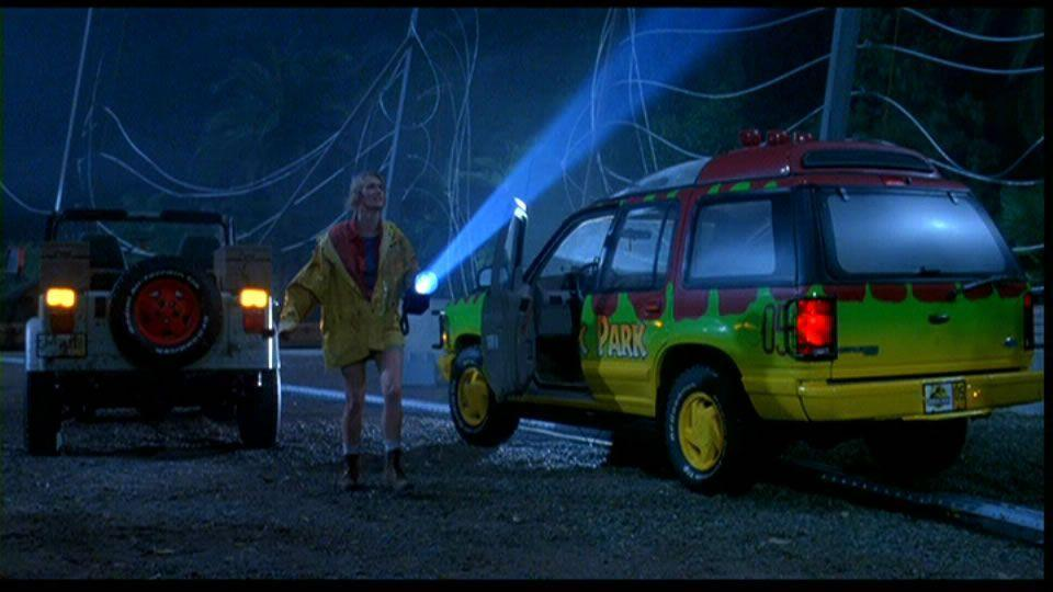 "<p>Hold onto your butts, we are now entering <em>Jurassic Park</em>, circa 1993. Though the cars appear to be Jeeps, they're really Ford Explorers, and a solid portion of the movie takes place in and around them. While these Touring Vehicles didn't see much off-roading, they are an integral part of the Jurassic Park experience—I mean before the dinos got loose and the characters realized they were stuck on Isla Nublar. Customized by Hollywood pro George Barris, many fans have been inspired to replicate the car, taking years to painstakingly re-create the '90s icons. </p><p>The cars were modified to give the illusion of automation by hiding the driver in the trunk, where they watched a small TV that was fed outside images via two cameras. Six cars were used in the film, charged at, stomped on, flipped over, and buffeted by prehistoric predators. Some were completely destroyed and at the end of filming three dumpsters had been filled with parts.</p><p><a class=""link rapid-noclick-resp"" href=""https://www.amazon.com/gp/video/detail/0PQE65KITY8UH80S2SC0M1L3FG/?tag=syn-yahoo-20&ascsubtag=%5Bartid%7C10054.g.27421711%5Bsrc%7Cyahoo-us"" rel=""nofollow noopener"" target=""_blank"" data-ylk=""slk:AMAZON"">AMAZON</a></p>"