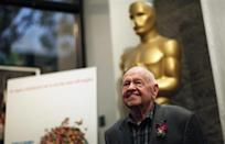 """Mickey Rooney poses at a screening of """"It's a Mad Mad Mad Mad World"""" to kick off The Last 70mm Film Festival at the Academy of Motion Picture Arts and Sciences in Beverly Hills, California, July 9, 2012. REUTERS/Mario Anzuoni/Files"""