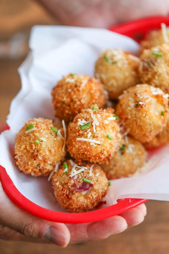 "<p>What's better than creamy mashed potatoes? Deep fried mashed potatoes. These mashed potato balls, loaded with bacon and cheese, are crisp and golden on the outside and soft and fluffy on the inside.<br>Get the recipe <a href=""http://damndelicious.net/2015/11/14/loaded-mashed-potato-balls/"" rel=""nofollow noopener"" target=""_blank"" data-ylk=""slk:here"" class=""link rapid-noclick-resp""><strong>here</strong></a><br>[Photo: Damn Delicious] </p>"