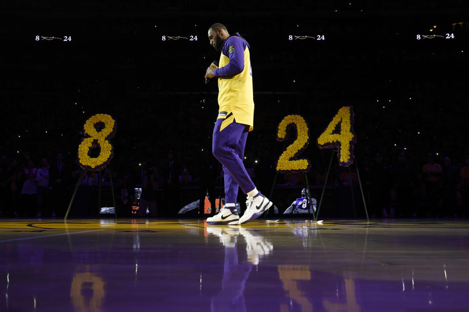 Los Angeles Lakers forward LeBron James looks down while speaking to the crowd about Kobe Bryant, prior to the team's NBA basketball game against the Portland Trail Blazers in Los Angeles, Friday, Jan. 31, 2020. (AP Photo/Kelvin Kuo)