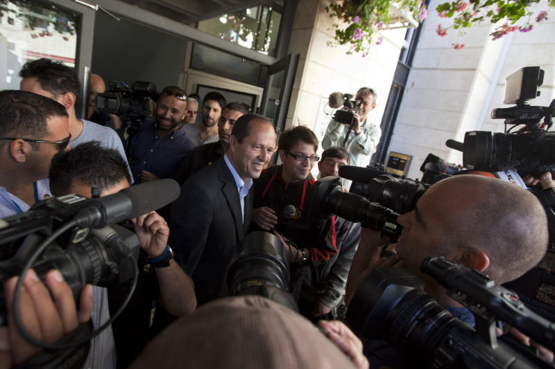 Jerusalem mayor Nir Barkat, center, speaks with journalists after voting in Jerusalem, Tuesday, Oct. 22, 2013. The mayors of Israel's two largest cities are fighting for their political survival in municipal elections with national implications. (AP Photo/Sebastian Scheiner)