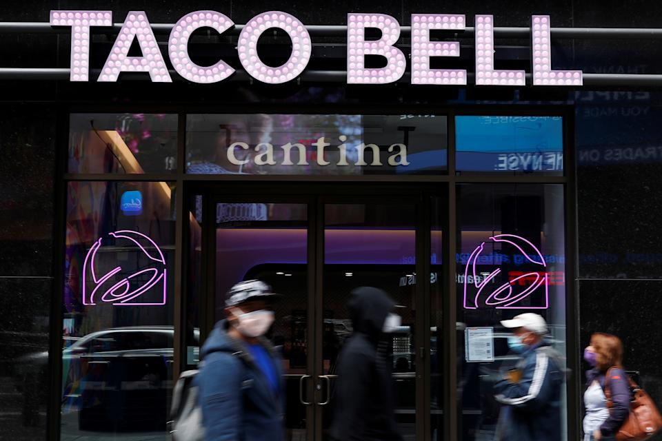 People walk by Taco Bell's first digital-only U.S. cantina location at Times Square in New York City, U.S., April 14, 2021. REUTERS/Shannon Stapleton