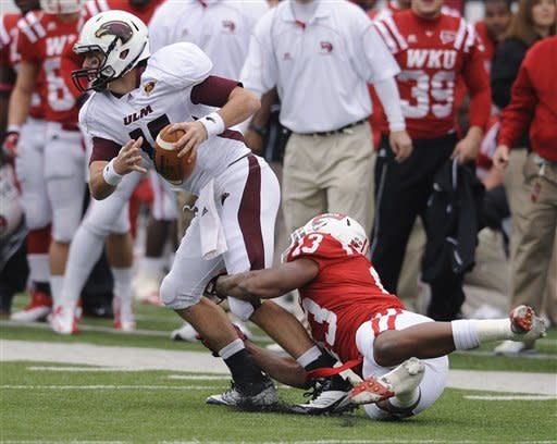 Louisiana-Monroe quarterback Kolton Browning (15) is taken down by Western Kentucky linebacker Xavius Boyd (13) during the first half of an NCAA college football game in Bowling Green, Ky., Saturday, Oct. 20, 2012. (AP Photo/Daily News, Joe Imel)