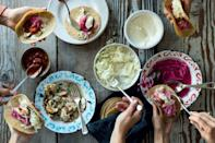"""This spiced fish is served on a corn tortilla with pickled red onion, Baja cream and slaw, and a spoonful of your favorite (store-bought or homemade) tomato salsa. This dish has a few elements, but most can be made ahead. <a href=""""https://www.epicurious.com/recipes/food/views/baja-fish-tacos?mbid=synd_yahoo_rss"""" rel=""""nofollow noopener"""" target=""""_blank"""" data-ylk=""""slk:See recipe."""" class=""""link rapid-noclick-resp"""">See recipe.</a>"""