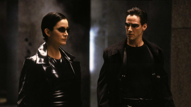 Carrie-Anne Moss as Trinity and Keanu Reeves as Neo in the 'Matrix' franchise. (Credit: Warner Bros)