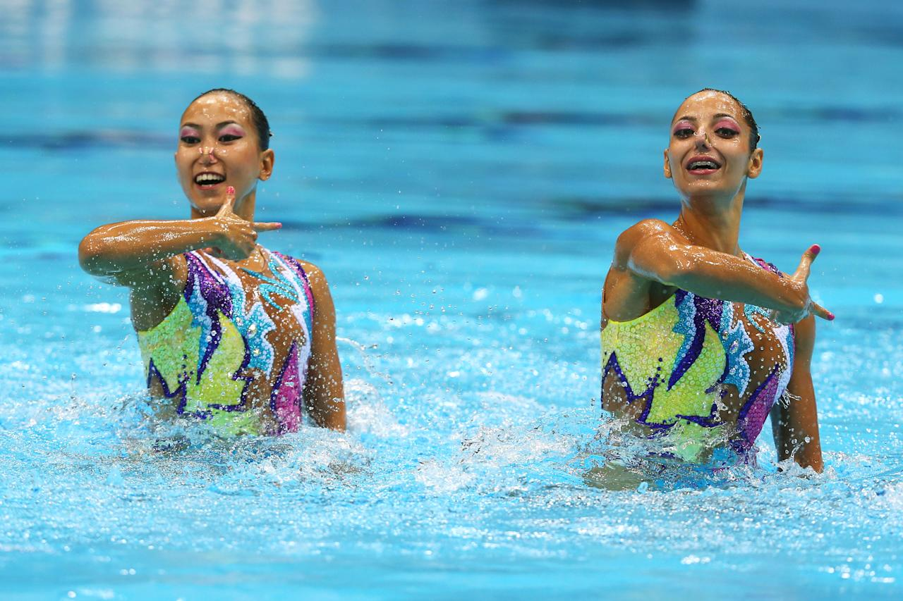 Eszter Czekus and Szofi Kiss of Hungary compete in the Synchronised Swimming - Duets - Technical Routine on Day 9 of the London 2012 Olympic Games at the Aquatics Centre  on August 5, 2012 in London, England.  (Photo by Clive Rose/Getty Images)