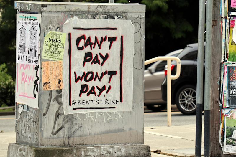 """SEATTLE, UNITED STATES - APRIL 30, 2020: A utility box in Seattle's Capitol Hill neighbourhood is covered in graffiti and posters calling for a rent strike. Thousands of residential tenants in several American cities have pledged to stop paying rent in what has been described as the largest planned """"rent strike"""" in the United States in decades.- PHOTOGRAPH BY Toby Scott / Echoes Wire/ Barcroft Studios / Future Publishing (Photo credit should read Toby Scott / Echoes Wire/Barcroft Media via Getty Images)"""