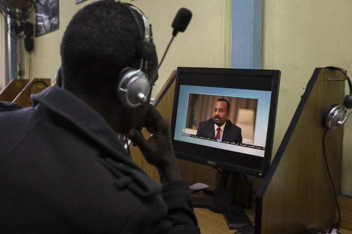 An Ethiopian streams a video of Prime Minister Abiy Ahmed speaking, at an internet cafe in the capital Addis Ababa, Ethiopia Thursday, Nov. 26, 2020. Ethiopia's prime minister said Thursday the army has been ordered to move on the embattled Tigray regional capital after his 72-hour ultimatum ended for Tigray leaders to surrender, and he warned the city's half-million residents to stay indoors and disarm. (AP Photo/Samuel Habtab)