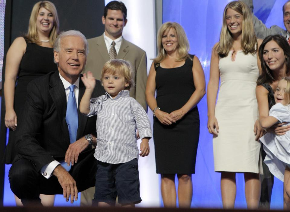 Democratic vice presidential candidate Sen. Joe Biden, D-Del., left, and other family members watch Biden's grandson Hunter wave from the stage at the Democratic National Convention in Denver, Wednesday, Aug. 27, 2008. (AP Photo/Jae C. Hong)