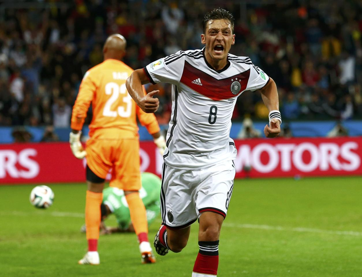 Germany's Mesut Ozil celebrates after scoring his team's second goal against Algeria during extra time in their 2014 World Cup round of 16 game at the Beira Rio stadium in Porto Alegre June 30, 2014. REUTERS/Darren Staples (BRAZIL - Tags: SOCCER SPORT WORLD CUP)