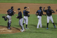 Miami Marlins' Francisco Cervelli (29) Nick Vincent (44) and Logan Forsythe (11) celebrate with teammates after a baseball game against the New York Mets Friday, Aug. 7, 2020, in New York. The Marlins won 4-3. (AP Photo/Frank Franklin II)
