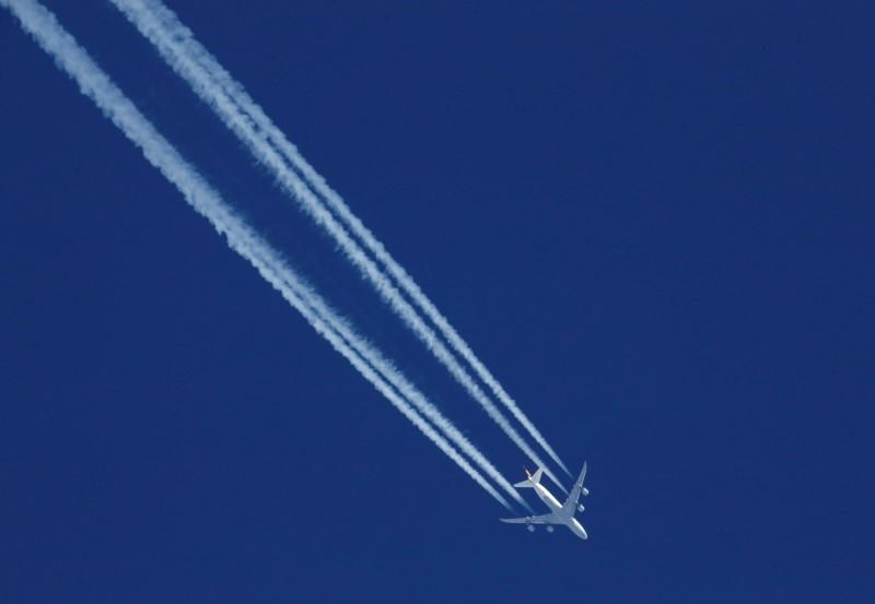 Contrails from a Lufthansa plane are seen in the sky over the ski resort of Val d'Isere