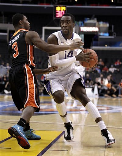 Oregon State's Ahmad Starks, left, pressures Washington's Tony Wroten during the first half of an NCAA college basketball game at the Pac-12 conference championship in Los Angeles, Thursday, March 8, 2012. (AP Photo/Jae C. Hong)