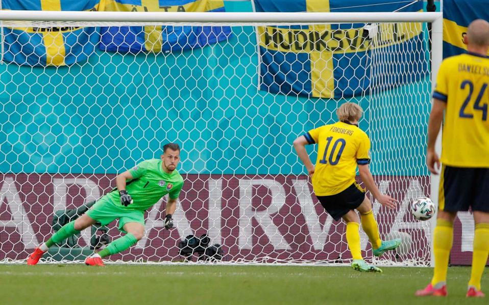 Emil Forsberg scores a penalty during the UEFA EURO 2020 Group E football match between Sweden and Slovakia at Saint Petersburg Stadium in Saint Petersburg on June 18, 2021. - GETTY IMAGES