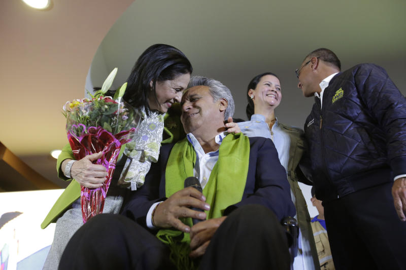 Alianza PAIS's presidential candidate Lenin Moreno and his wife Rocio Gonzalez, and Cinthia Díaz and her husband vice presidential candidate Jorge Glas, back, share a moment at the end of election day, in Quito, Ecuador, Sunday, April 2, 2017. (AP Photo/Dolores Ochoa)