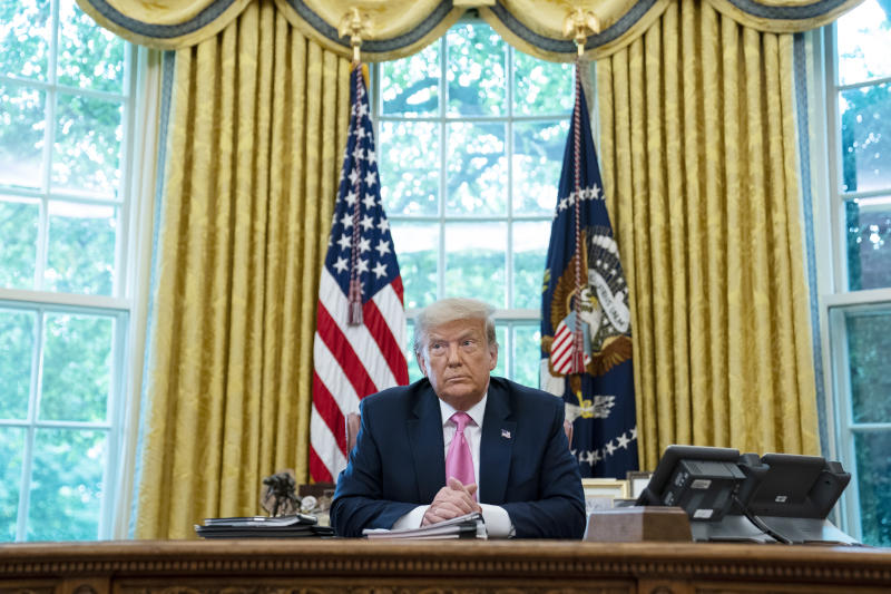 President Donald Trump listens during a meeting with Senate Majority Leader Mitch McConnell of Ky., and House Minority Leader Kevin McCarthy of Calif., in the Oval Office of the White House, Monday, July 20, 2020, in Washington. (AP Photo/Evan Vucci)