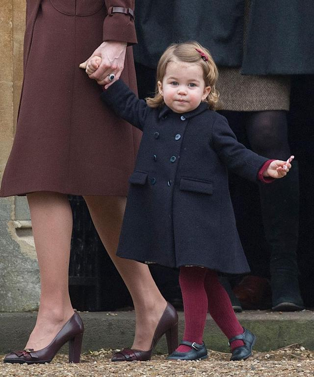 <p>Princess Charlotte attended a church service on Christmas Day in 2016 and dressed for the occasion in a double-breasted pea coat and burgundy tights. (Photo: Getty Images) </p>