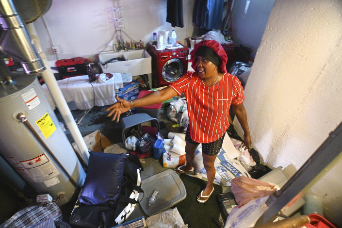 Mary Mason shows her frustration after floodwaters damaged her basement in Detroit on Saturday, June 26, 2021. (Max Ortiz/Detroit News via AP)