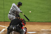 Chicago White Sox Jose Abreu hits a solo home run during the first inning of a baseball game against the Cincinnati Reds, Tuesday, May 4, 2021 in Cincinnati. (AP Photo/Aaron Doster)