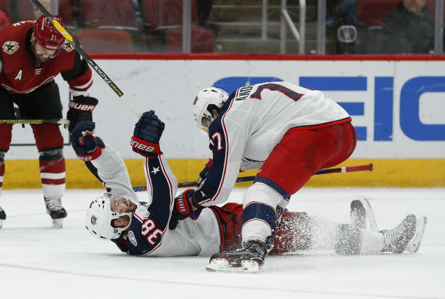 Columbus Blue Jackets center Boone Jenner (38) celebrates with Josh Anderson (77) after scoring a goal during the third period of an NHL hockey game against the Arizona Coyotes, Thursday, Feb. 7, 2019, in Glendale, Ariz. Columbus won 4-2. (AP Photo/Rick Scuteri)