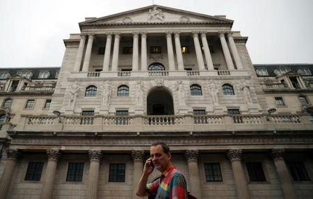 A man speaks on his phone outside the Bank of England in the City of London