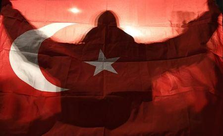 File Photo: A demonstrator holds a Turkish flag outside the Turkish consulate in Rotterdam