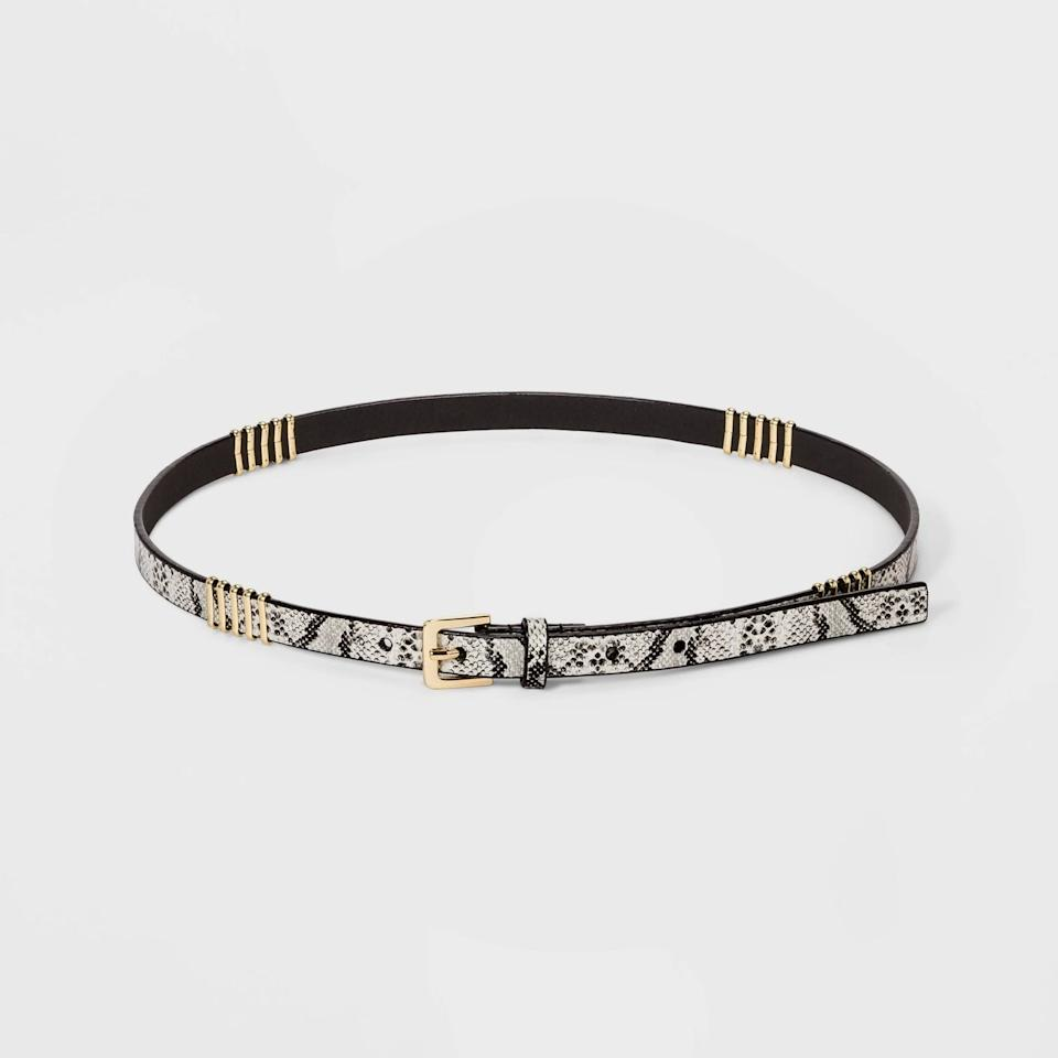 """<p><a href=""""https://www.popsugar.com/buy/New-Day-Snake-Print-Thin-Belts-Metal-Wrap-548183?p_name=A%20New%20Day%20Snake%20Print%20Thin%20Belts%20With%20Metal%20Wrap&retailer=target.com&pid=548183&price=12&evar1=fab%3Aus&evar9=47206489&evar98=https%3A%2F%2Fwww.popsugar.com%2Ffashion%2Fphoto-gallery%2F47206489%2Fimage%2F47206911%2FNew-Day-Snake-Print-Thin-Belts-With-Metal-Wrap&prop13=mobile&pdata=1"""" rel=""""nofollow"""" data-shoppable-link=""""1"""" target=""""_blank"""" class=""""ga-track"""" data-ga-category=""""Related"""" data-ga-label=""""https://www.target.com/p/women-39-s-snake-print-thin-belts-with-metal-wrap-a-new-day-8482-snake-l/-/A-54512339?ref=tgt_adv_XS000000&amp;AFID=google_pla_df&amp;fndsrc=tgtao&amp;CPNG=PLA_Accessories%2BShopping_Local&amp;adgroup=SC_Accessories&amp;LID=700000001170770pgs&amp;network=g&amp;device=c&amp;location=9004077&amp;gclid=EAIaIQobChMI0ejV65jI5wIVy4FaBR21Xw3PEAQYCSABEgL4a_D_BwE&amp;gclsrc=aw.ds"""" data-ga-action=""""In-Line Links"""">A New Day Snake Print Thin Belts With Metal Wrap</a> ($12, originally $15)</p>"""