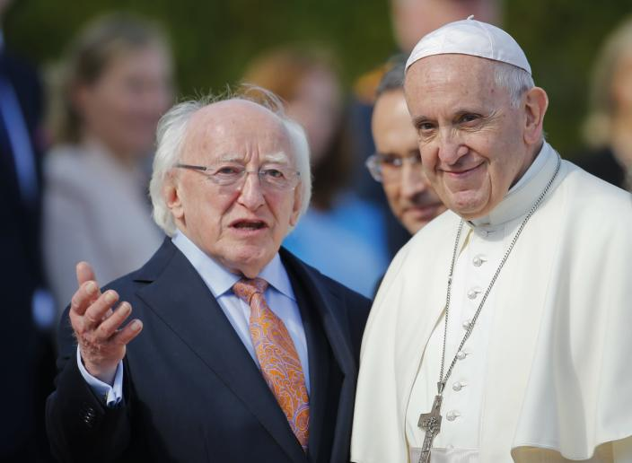 Pope Francis, right, is flanked by Irish President Michael D. Higgins, upon his arrival at the Presidential residence in Dublin, Ireland, Saturday, Aug. 25, 2018. Pope Francis is on a two-day visit to Ireland. (AP Photo/Peter Morrison)