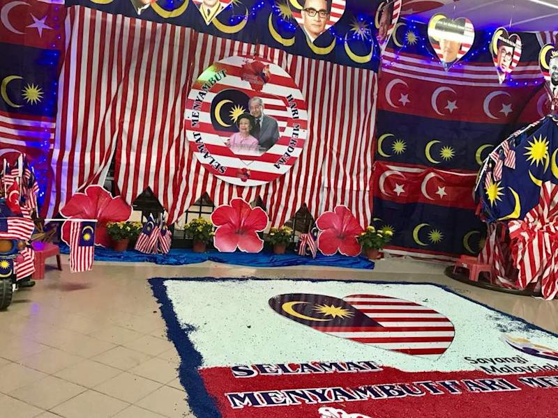 M. Kandapan's porch has been turned into a large kolam area featuring the Jalur Gemilang and national flower, the hibiscus. — Picture by Ben Tan