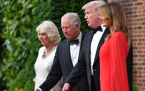 US President Donald Trump (2R) and US First Lady Melania Trump (R) greet Britain's Prince Charles, Prince of Wales (2L), his wife Britain's Camilla, Duchess of Cornwall, ahead of a dinner at Winfield House - Credit: MANDEL NGAN / AFP