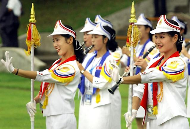 North Korean cheer learders perform during the welcoming ceremony for the 2003 World Students Games in Daegu, South Korea (AFP Photo/KIM JAE-HWAN)