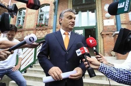 Hungary's Prime Minister Orban talks to journalists after casting his vote during European Parliamentary elections in Budapest,