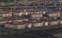 An aerial view from a helicopter shows residential houses recently constructed for the 2014 Winter Olympics in the Adler district of the Black Sea resort city of Sochi, December 23, 2013. Sochi will host the 2014 Winter Olympic Games in February. Picture taken December 23, 2013. REUTERS/Maxim Shemetov (RUSSIA - Tags: CITYSCAPE BUSINESS CONSTRUCTION SPORT OLYMPICS)