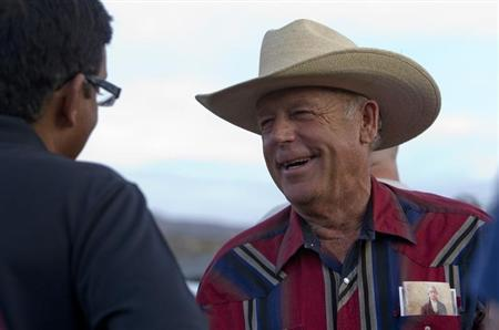 "Rancher Cliven Bundy greets a supporter during a Bundy family ""Patriot Party"" near Bunkerville, Nevada"