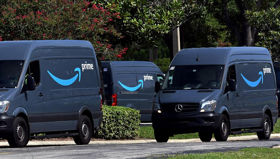 Amazon vans head to a distribution center to pick up packages for delivery on Amazon Prime Day, July 16, 2019, in Orlando, Florida.  (Photo by Paul Hennessy/NurPhoto via Getty Images)
